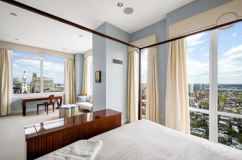 Master Bedroom Interior (with a view of City Hall) Real Estate Photography of the Symphony Penthouse Suite in Philadelphia, PA for Kurfiss Sotheby's International Realty.