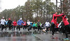 Community Motivation-Training group warms up before cold, wet run
