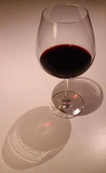 Glass with purple wine
