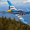 Original aircraft image taken at the Olympic Air Show, Olympia Washington.  Background image taken from Mount Constitution on Orcas Island, Washington.  The two images were combined using Photoshop.