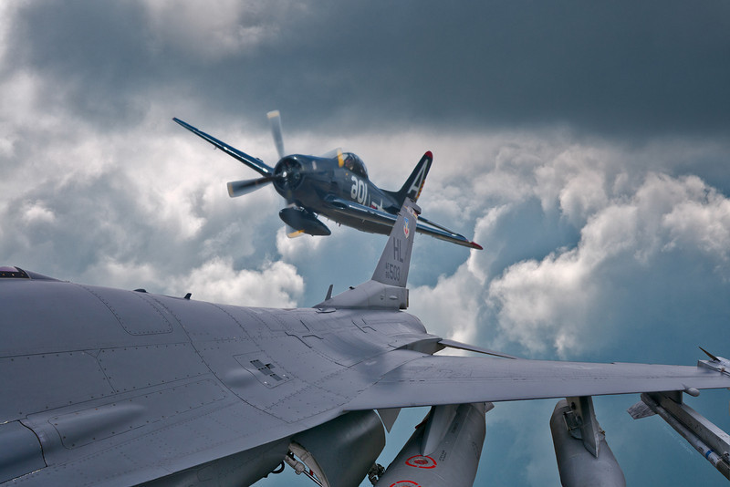 Looking back in time from a F-18 Fighting Falcon at a World War II vintage F8F Bearcat.