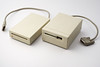 Macintosh original 400K external drive (1984) and a 800K external drive (1986).