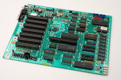 Apple ][ pictures. Late Apple //e motherboard, without the additional circuit (and without the Apple ROMs).