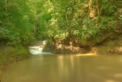 """This is the bottom of the """"Agua Viva, Catarata d'"""" waterfall.  The water was full of minerals and was not clear.  It was still pretty warm."""