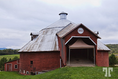Round barn - Mansonville, Quebec  This is a fantastic structure built in 1912. It has 3 levels: the lower was for the cows, the medium level for hay, and the upper level where the ramp goes was for hay wagons. Today it's used as a Sunday farmers' market.