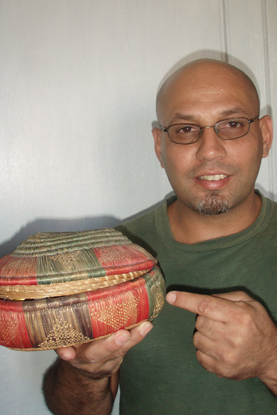 Havana percussionist Danilo shows off an Ethiopian basket brought to Cuba by a relative who had worked in Ethiopia