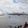 Crowds watch the Three Queens from the banks of the Mersey.