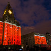 Three Graces lit up in red, presenting the underside of the Three Queens.