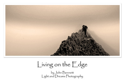 "11.09.15 - Living on the Edge  I was re-working some old mountaineering photos for a project yesterday and decided to turn this one into a poster. The knife edge ridge is called ""Crib Goch"" and it is on the mountain Snowdon in North Wales, which is the highest in England and Wales. I've done it a few times in sunshine, mist and snow, this was one of the misty ones. I did a monochrome conversion and added a slight sepia filter, which adds to the atmosphere I think, but it was pretty monochrome to start with."