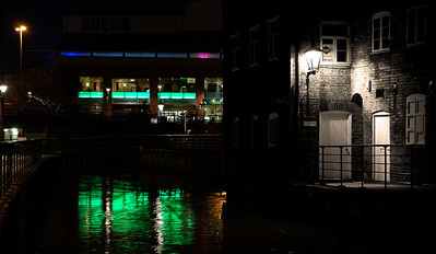 05.04.12 - Two Worlds  This is a shot from our photo walk last night. I was taken by the splashes of light down by the waterside, the green neon glow of the modern restaurant in the distance and the corner of light from the old style lamp on the brickwork. I've done a selective B&W conversion, with a hint of sepia filter, to accentuate the old building, so it almost looks like a composite photo, but this really is one image.  Thank-you for your responses to my sci-fi bit of fun yesterday :)
