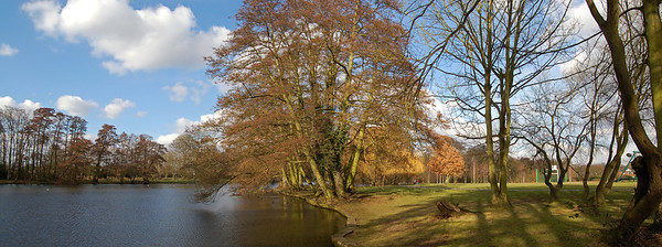 26.03.13 - Water and Land  Spring sunshine at last? Well yes and no. The sunshine yesterday was a pleasant change, but the camera can't pick up the biting east wind that cut right through you.   This is a 2 shot photomerge panorama. I had intended to have another frame on the left, but the lighting was so different they were never going to join up. Such a 50/50 split shouldn't work, but I think the way the trees in the centre overhang the water helps balance the shot, and it is nice to see Spring colours at last.