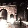 "12.02.13 - Lights, Camera, Action.....<br /> <br /> This is a re-working of an image from a photo walk I led back when we had snow on the ground recently. The arch is called Priorygate, with Lincoln Cathedral to the right. My friend Mark is standing by the arch getting some spectacular shots with a fish eye lens. It is a 6 second exposure to capture the traffic streaming through the arch, and I have applied the ""monday morning"" filter in color efex pro to create a slight glow and near monochrome."