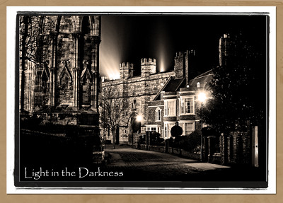 """3.1.11 - Shine  I finally got some sleep last night and felt a bit better today. After dark I decided to take a short walk with the camera, and even took my tripod along! I only intended going to the local shops and looking for a subject there, but the freezing night air cleared my tubes and I ended up in the Cathedral Quarter. Unfortunately I hadn't checked the camera battery, and it died after a few shots. Handling a tripod isn't recommended in freezing temperatures either, so I definitely chose a bad time to venture out with it, but hey, all lessons learned are good ones.   This is the first """"antique postcard"""" effect image I've used for a Daily since September, there is a different monochrome treatment of the same shot here;   http://www.lightanddreamsphotography.com/gallery/15316442_WFv49#1146043514_Q3CYf"""
