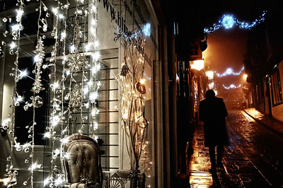 """28.12.10 - Through the Looking Glass  This is a shot from early evening in the fog. I love shooting in fog at night, with the wet cobbles reflecting all the lights, but it gets very hard to find new perspectives in an area you know so well. I've done this 2/3s split in a shop window before, but hopefully the bleach bypass treatment gives it a different feel. The original is here with a few more shots from this evening;    http://www.lightanddreamsphotography.com/gallery/4222541_LCXPH#1139857573_5JP5r  I'm already wondering if this would work well for the new Dgrin Challenge theme """"Glass""""?"""