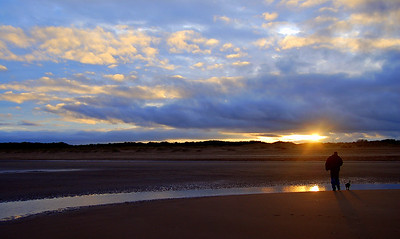 14.1.11 - Down by the Sea  This is another photo from yesterday, down at the coast with Phil (Nix) and his 10 week old puppy Pip.It was Pip's first trip to the coast and of course he loved it. We had the beach to ourselves and the light was wonderful, we only left when it started to get dark!  Thank-you for the wonderful comments on my 'a**e in the window' pic yesterday, it was quite a find. Also huge thanks for everyone who voted me into =2nd place in the latest Dgrin Challenge, that was a wonderful surprise at the end of a difficult week.