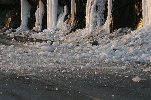 Ice peeling off a climbing wall along the Seward Highway created quite a road hazard for the cars.