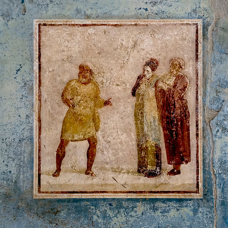 Image taken of painting on wall in Pompeii. The man on the left seems to be explaining something to the woman in the center. She seems intent on absorbing the information he is conveying, but appears to be deciding whether or not to give much credence to his story. Perhaps she is not sure how much to trust his motives or judgement. The woman is accompanied by the woman on her left who seems to convey or attempt to convey an air of authority. The woman in the center perhaps seeks her confirmation of impressions as well as advice.