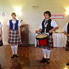 The pipers and dancers came by to entertain us.