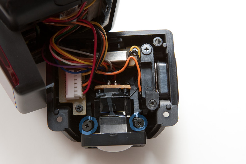 Gently pull the foot , being careful not to disconnect any wires.  Unscrew the autofocus LED