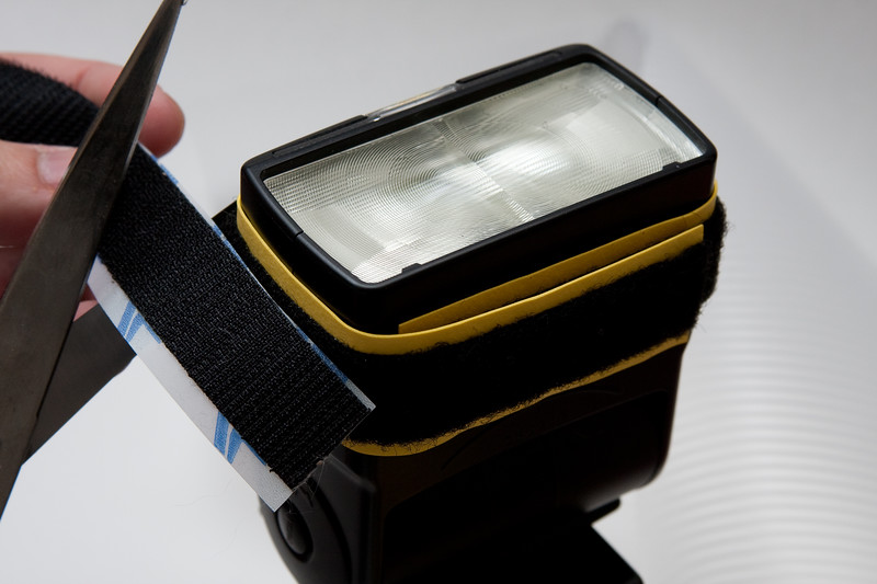 """Cut a four pieces of hook tape and four pieces of loop tape, each to the height of your flash.  For the Canon 550EX, that's about 1-3/4"""""""