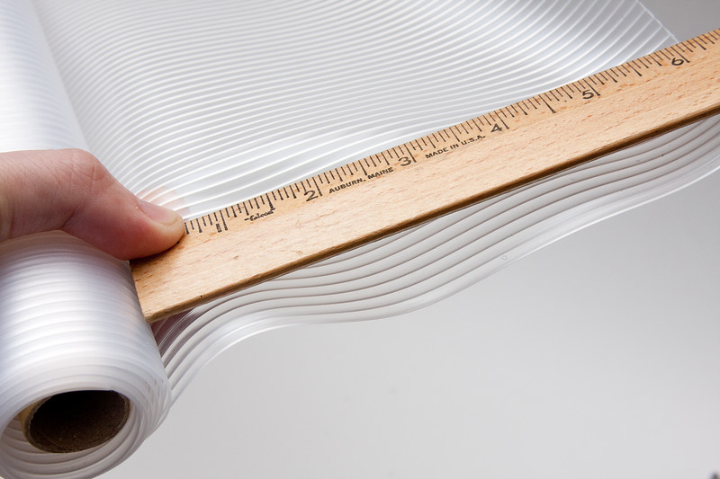 """Cut out a strip to the length you determined in the previous step.    For Canon 550EX, that's about 18""""x7"""" (not the 6"""" pictured)"""