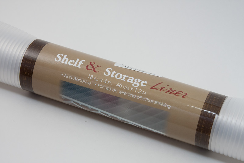 Start with this clear polyvinyl shelf liner, which runs about $5 at your local WalMart