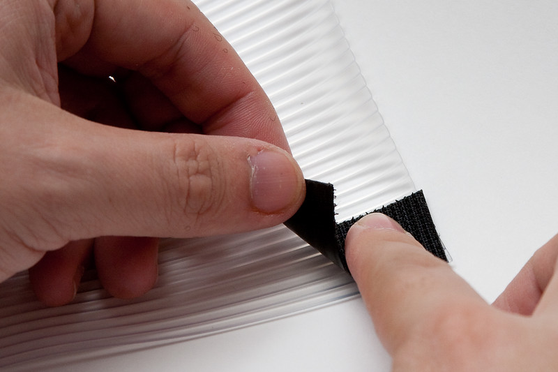 Stick hook tape to the smoother side of the vinyl at each corner.  If you're using this with the DIY gels, the stick an additional piece of hook tape in between these two corner pieces.