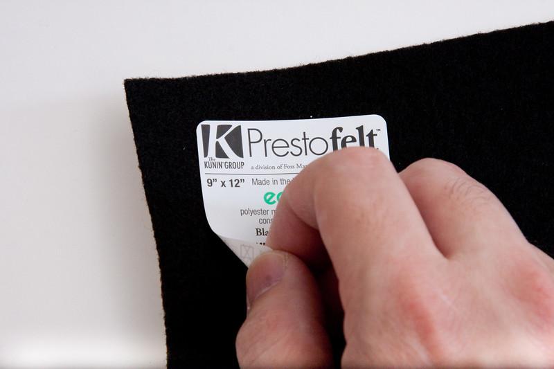 Peel off label from felt.
