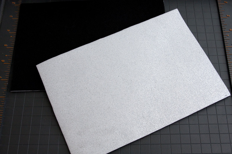 """You should now have two pieces roughly 4"""" x 9"""" in size, with one matte felt side and one reflective foam side."""