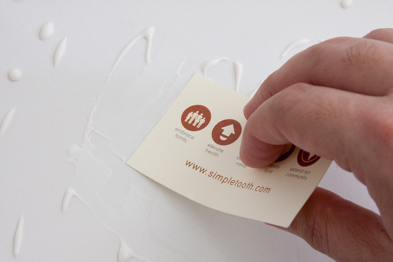 Use a paintbrush or a business card to spread the glue evenly, and edge to edge.