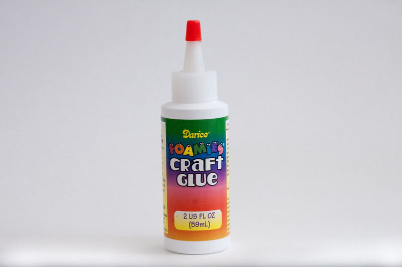 One small bottle of foam glue.  It looks like Elmer's white glue, but there's something in it that makes foam stick.  Elmer's doesn't work well; I've tried.