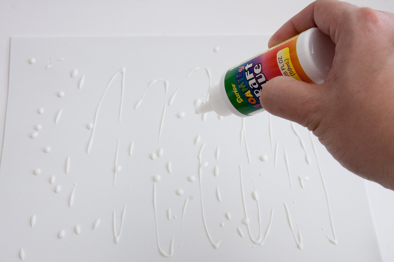Apply glue as evenly as possible to the back side of the foam.  (white foam doesn't matter which side)