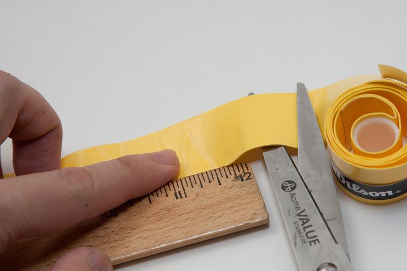 Cut twelve inch strips of grip tape