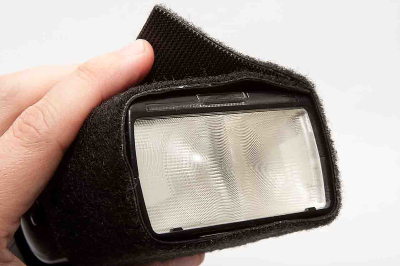 Wrap the completed strap tightly around flash.  When you're done, you simply peel off the strap.  Do not leave the strap on your flash in hot environments, as the adhesive may melt onto your flash.