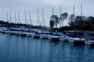 7:38 PM. Night falls over Lake Mission Viejo's sailing fleet.