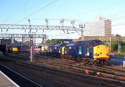 37059 and 37608 heading for Valley with 37218 and 37259 on the left waiting to depart to Ditton. June 2006.