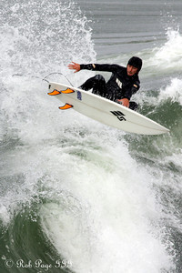 Daily favorite for April 27, 2012  A month ago I was in California to visit with friends and spent some time at the Huntington Beach Pier.  There were some surfers and a storm rolling in leading a great photo opportunity.  Here is one of the more interesting shots.  Surfing - Huntington Beach, CA ... March 16, 2012 ... Photo by Rob Page III