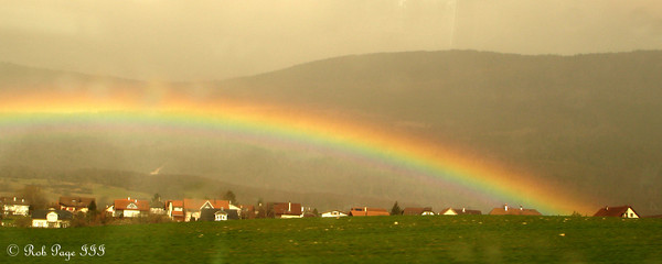 Daily photo for August 27, 2009 (View the image in its  original gallery):  A rainbow over the Suisse countryside on our way to Murten - Switzerland ... March 3, 2007 ... Photo by Rob Page III