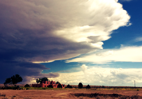 Adobe Home at the Edge of the Storm