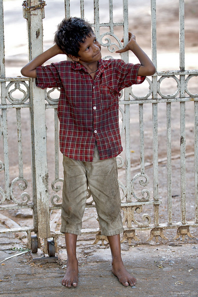 Smile!<br /> 29 May 2010<br />  <br /> A street urchin enjoys posing for Darshan near the museum's gate. Shot during Sunday photo-walk.