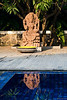 Reflection<br /> 25 June 2010<br /> <br /> The statue with detailed carving and the leaves of the tree were reflected beautifully in the swimming pool at my friend's house.  Best seen in Large size.