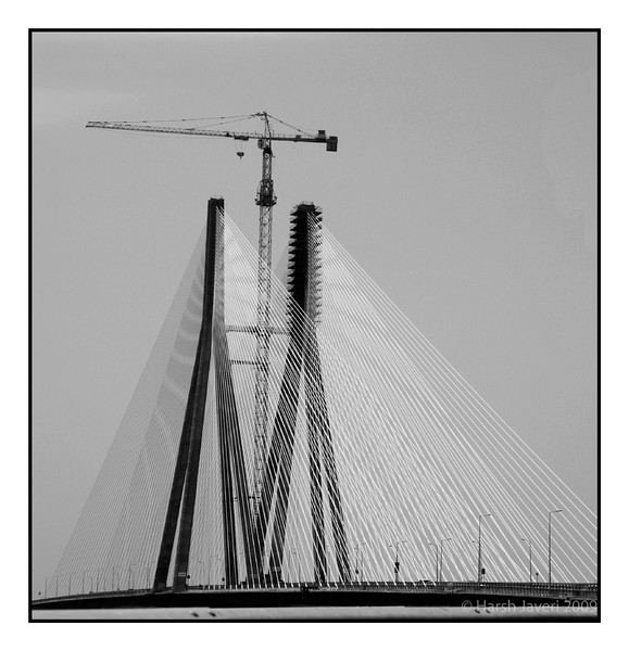 "Bandra - Worli sea link (Pic 252 2nd year - 27 Sep 2009)<br /> <br /> Shot from the car on way back from the airport. And no I wasn't driving! :)<br /> Converted to B&W<br /> <br /> <br />  <a href=""http://www.javeri.net"">http://www.javeri.net</a>"