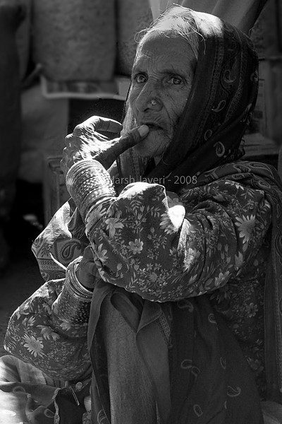 "Lost in thought - BW (Pic 199 2nd year)<br /> <br /> This is the B&W version of the colour shot posted today. <br /> The old lady selling strawberries & berries at the market in Mahabaleshwar.<br /> What would be your choice - colour or B&W? <br /> <br /> Best seen in XLarge size.<br /> <br />  <a href=""http://www.javeri.net"">http://www.javeri.net</a>"