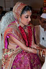 """Indian bride <br /> (003 2nd year)<br /> <br /> This beautiful lady is my friends' daughter who got married last Monday. Two days ago I had put up a shot of her foot with Mehendi: <br />  <a href=""""http://hershy.smugmug.com/photos/559107962_zckEs-L.jpg"""">http://hershy.smugmug.com/photos/559107962_zckEs-L.jpg</a><br /> <br /> To answer Curious Camel:<br /> The bridegroom is holding her hand. Beetle leaf and nut are put in the hands of the bride and then the groom covers her hand with his, making it a 'union' of two people. <br /> <br /> <br />  <a href=""""http://www.javeri.net"""">http://www.javeri.net</a>"""