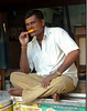 "Ice candy! (Pic 295 2nd year - 19 Nov 2009)<br /> <br /> Shot at Dhobi ghat. Sitting on top of the ice box he was cooling off with an ice candy. <br /> <br />  <a href=""http://www.javeri.net"">http://www.javeri.net</a>"