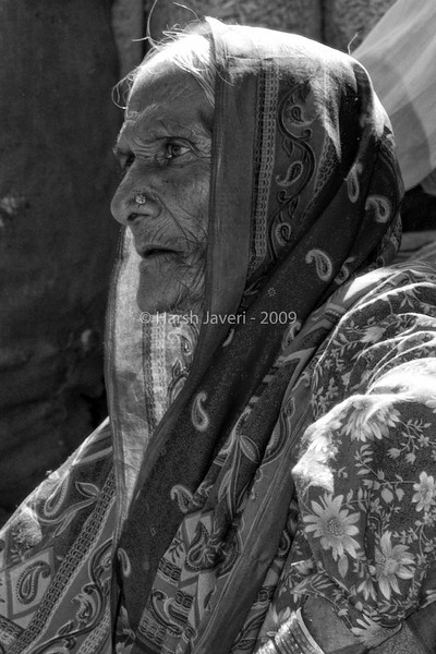 "What lies ahead... (Pic 200 2nd year)<br /> <br /> This is the last shot of the lady in the market in Mahabaleshwar.  Here I've opted for B&W as it brings out the character of the lady, her age, hardships etc. <br /> <br /> Thank you all for your valuable comments on her two shots posted yesterday. What most of you have said is true, the B&W shows more character while the colour one is a colourful portrait. <br /> <br /> Lavanya, you had asked for a close-up of the lasy, hope this is good enough... :)  <br /> <br /> Best seen in XLarge size.<br /> <br />  <a href=""http://www.javeri.net"">http://www.javeri.net</a>"