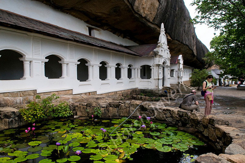 "Dambulla rock temple (Pic 188 2nd year)<br /> <br /> Perched on a hill, the temple was built by king Walagambahu in the 1st century B.C. and is the most impressive of Sri Lanka's cave temples plus a World Heritage Site.  <br /> <br /> The complex of five caves with over 2000 sq. metres of painted walls and ceilings, is the largest area of paintings found in the world. It contains over 150 images of the Buddha of which the largest is the colossal figure of the Buddha carved out of rock and spanning 14 metres.Hindu statues are believed to be of the 12 century AD and the latest paintings are of the late 18-century.<br /> <br /> Dambulla is a small town located at a distance of 19 km from Sigriya on the Sigriya-Kandy road. Dambulla has over 80 caves in the surrounding and some of them have been used by the monks as meditation locations. <br /> <br />  <a href=""http://www.javeri.net"">http://www.javeri.net</a>"