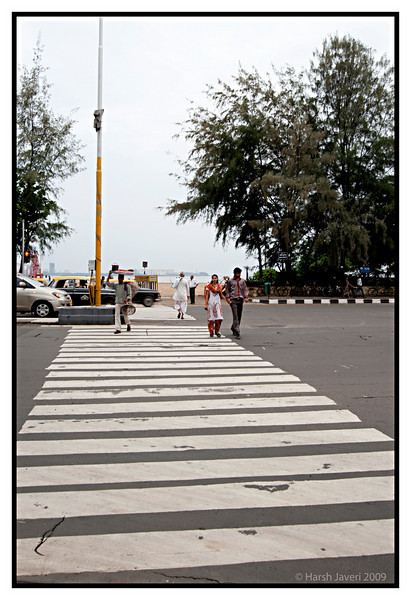 "Zebra crossing (Pic 238 2nd year - 13 Sep 2009)<br /> <br /> Beyond the crossing is Girgaum Chowpatty (beach), 5-7 minutes walk fro my house. <br /> <br />  <a href=""http://www.javeri.net"">http://www.javeri.net</a>"