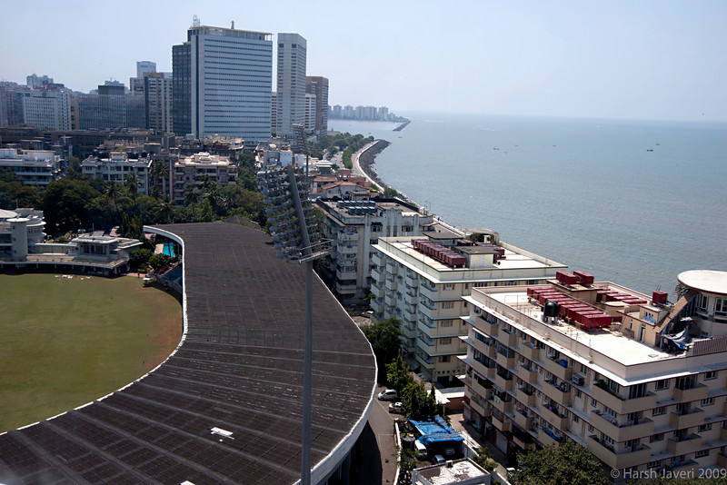"Nariman Point (Pic 285 2nd year - 30 Oct 2009)<br /> Best seen in XLarge size<br /> <br /> Taken from the rooftop restaurant The Pearl of the Orient at Hotel Ambassador.<br /> <br /> What I liked was the curve of the stadium against the curve of the road on the right. <br /> <br /> Brabourne stadium at left bottom. The tall buildings are on Nariman Point which is a reclaimed area. The squarish building is Air India followed by Trident & Oberoi hotels. The hotels were one of the targets during the terrorist attack in November 2008.<br /> <br /> <br /> More pics at<br />  <a href=""http://hershy.smugmug.com/Photography/Mumbai-my-city/Ambassador/9787785_wombx/1/663916178_GUxXp"">http://hershy.smugmug.com/Photography/Mumbai-my-city/Ambassador/9787785_wombx/1/663916178_GUxXp</a><br /> <br />  <a href=""http://www.javeri.net"">http://www.javeri.net</a>"