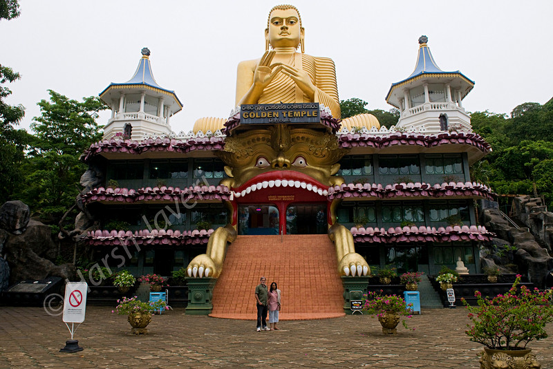 """Golden temple, Dambulla, Sri Lanka. (Pic 185 2nd year)<br /> <br /> Dambulla  is a small town located at a distance of 19 km from Sigriya on the Sigriya-Kandy road. This temple is at the base of the hill that has Dambulla Rock Temple. <br /> <br /> That's Swarup & myself at the base. <br /> <br /> Shot by my friend when we visited Sri Lanka last year but processed recently! <br /> <br />  <a href=""""http://www.javeri.net"""">http://www.javeri.net</a>"""